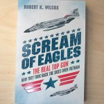 "Cover illustraion of a F-4J Phantom on Orion Books ""Scream of Eagles"" publication."
