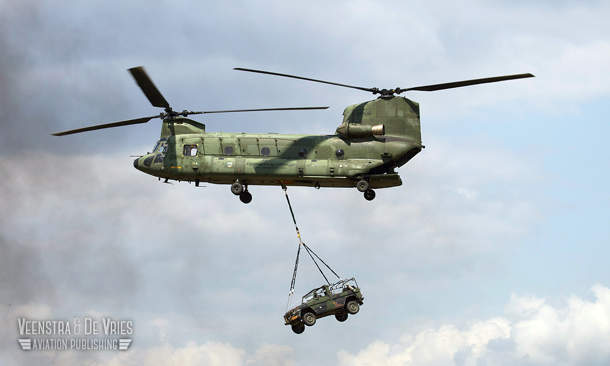 A RNLAF CH-47 Chinook carries a Wolf light skinned vehicle as a underslung load. Image copyright Lieuwe de Vries - 2014